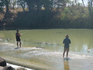 A spot of fishing at Cahill's Crossing, note the crocodile waiting for a catch as well!